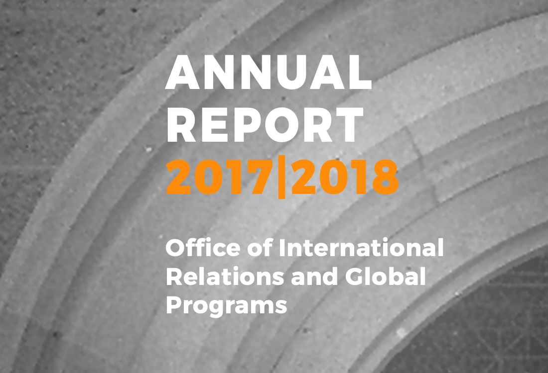 2017|2018 Annual Report with a stone arch in the background