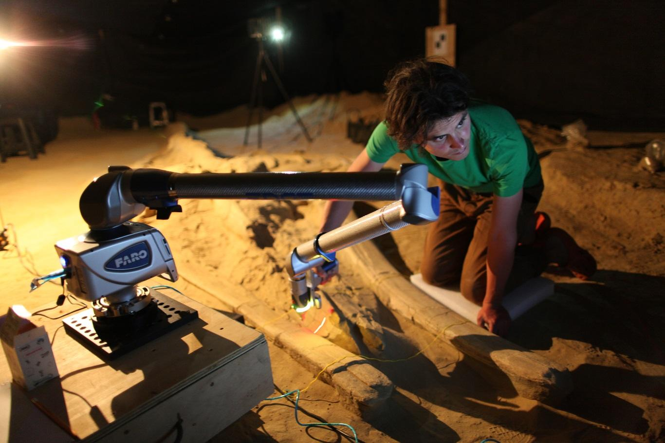 Inside the tent at night, 3D scanning MPC 677, the most complete fossil rorqual from Cerro Ballena, in 2011. Photo Credit Smithsonian Institution