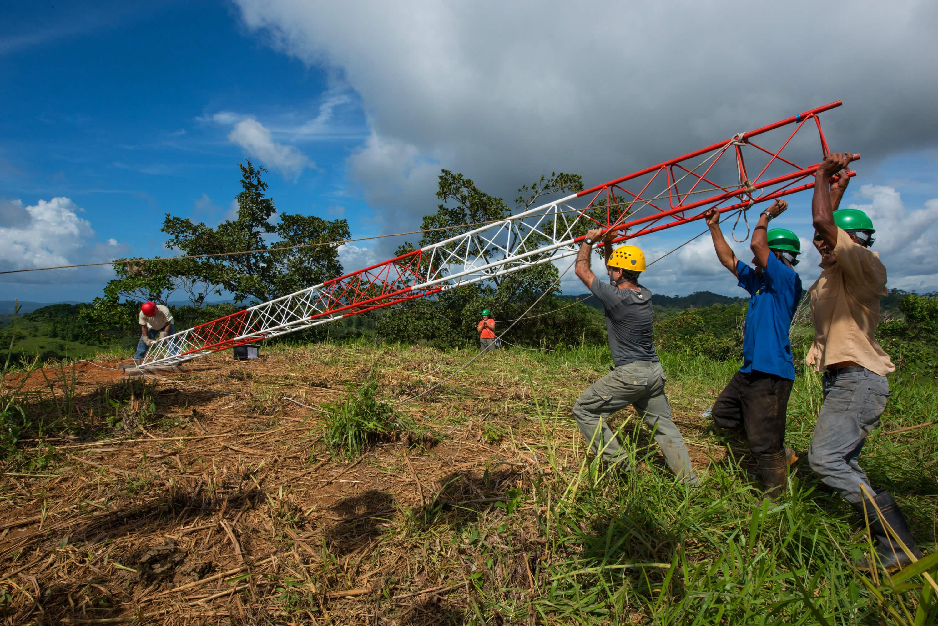 Technicians from the STRI Physical Monitoring Program install a meteorological tower. Two strategically located meteorological stations were made possible with support from the Heising-Simons Foundation. Photo credit Jorge Aleman.