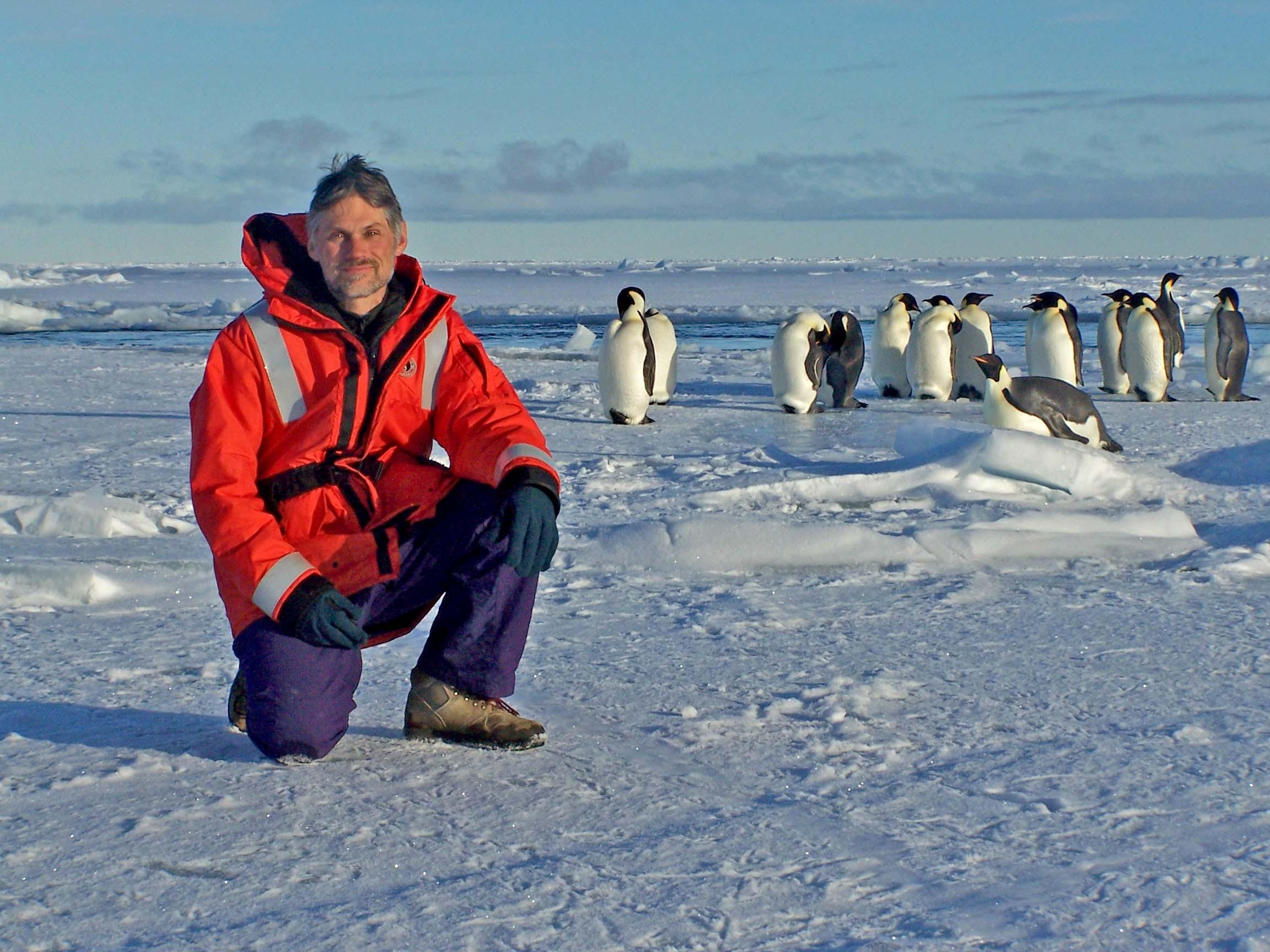 Pat Neale with some of the locals in Antarctica. Credit: SERC.