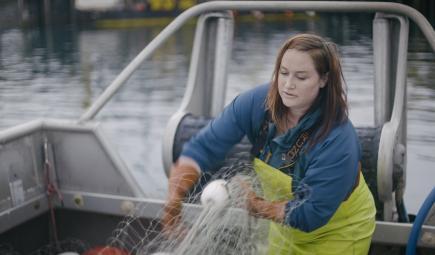 A salmon fisherwoman in her boat.