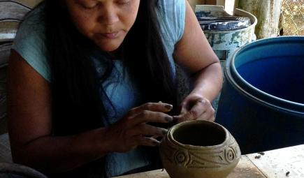 Puerto Rican female artisan creating pottery