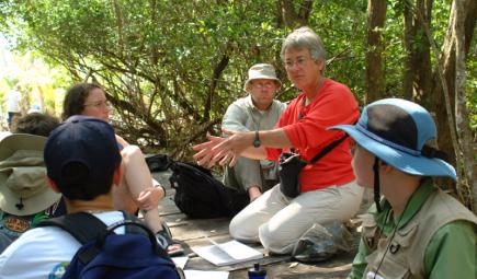 Ecologist teaching students outdoors in Belize
