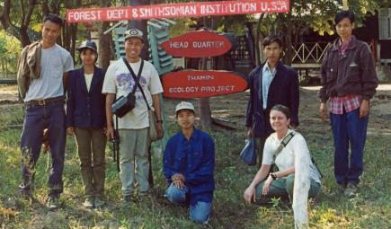Ecology team members posing at welcome sign for wildlife sanctuary