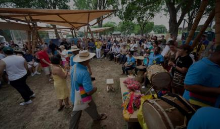 Musicians and audience at cultural celebration in Colombia