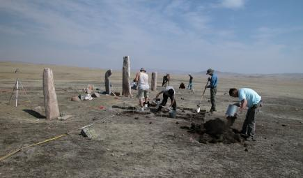 Excavation team near deer stones