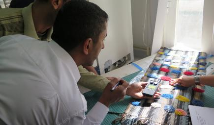 Iraqi students monitor light levels.