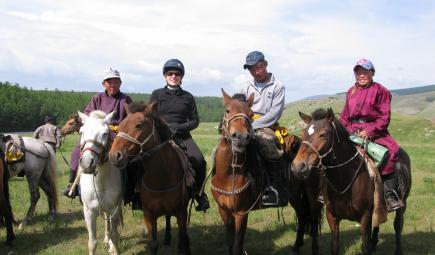 Ethnobotanist and guides riding horses in Mongolia