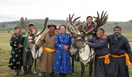 Tsaatan guides and families posing with reindeer