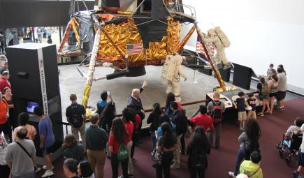 Science students from Palestine look at Apollo 11