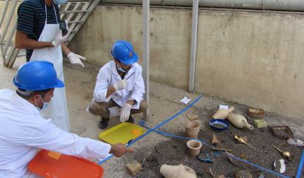 Iraqi cultural heritage professionals practice salvage techniques.