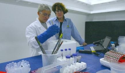 Scientists study vials of reef samples