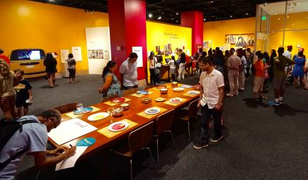 Visitors examine exhibit objects