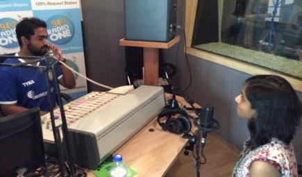 Radio presenter interviews head curator in studio