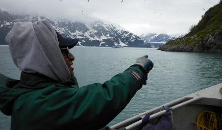 Yakutat Tlingit elder on boat near sealing camp in Alaska