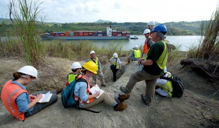 Biogeography researchers at paleontological excavation site by Panama Canal