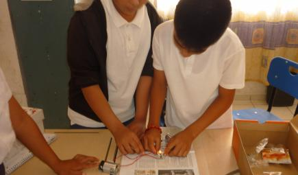 Students learn about electric circuits in the classroom.