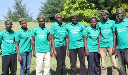 Trainees from local community pose near forest plot