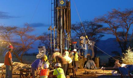 Crew working at drilling site at nighttime