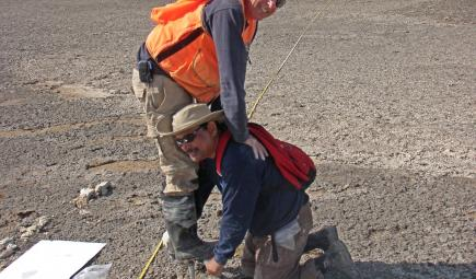 Biogeochemists collecting core deposits from salt flat
