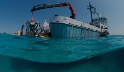 Underwater capsule Curasub launches from a research vessel crane