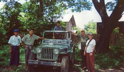 Team of ecology researchers pose next to truck