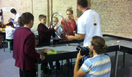 Kids studying science with bike wheel in Ukraine