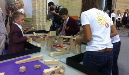 Kids modeling innovation with wooden blocks in Ukraine