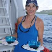 Carole Baldwin and lionfish sashimi. Photo Credit Barry Brown