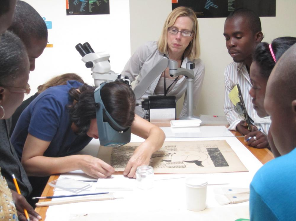 Smithsonian conservators Emily Jacobsen (FSG, left) and Rosemary Fallon (NPG, center) teach a workshop on basic paper stabilization methods. Photo credit Stephanie Hornbeck.