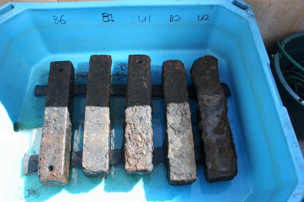 Iron ballast recovered from the São José slave shipwreck undergoing treatment. The ballast was used to weigh down the slave ship and its human cargo. Credit: Iziko Museums