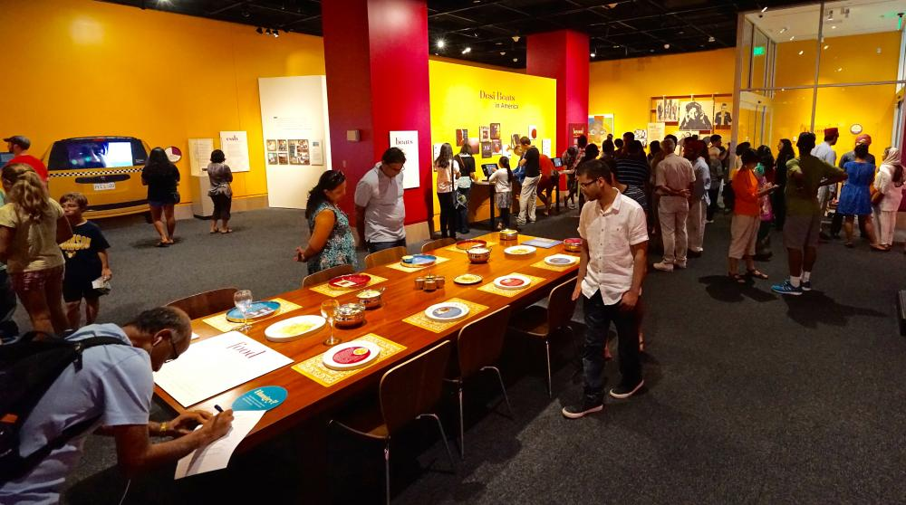 "Visitors in the ""Beyond Bollywood"" exhibition at the National Museum of Natural History, August 2015. Photograph by Shan Jalla. Courtesy: Smithsonian Asian Pacific American Center"