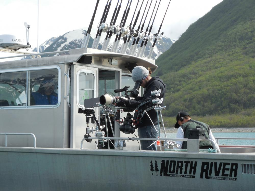 Filming the Yakutat seal hunt: Nicholas Bradford and Brandon McElroy setting up gyro-mounted video cameras on the ASC's chartered chase boat. Photo credit: Aron Crowell.