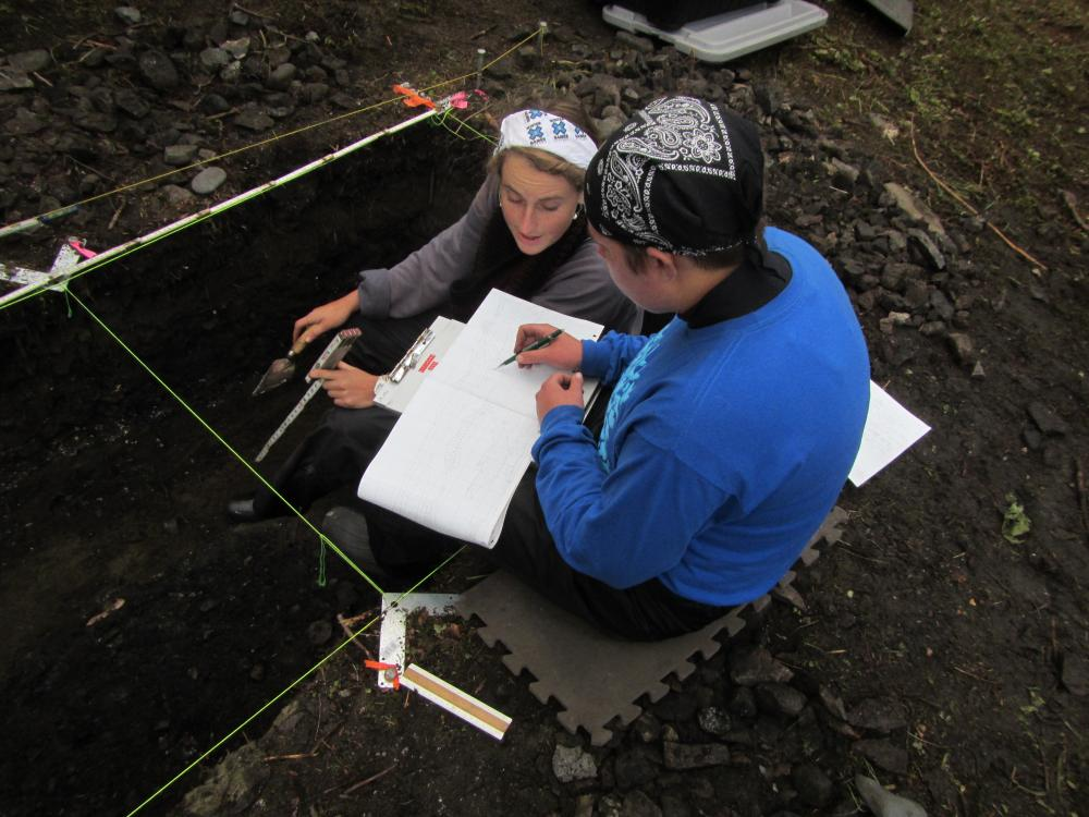Students excavating seal bones at the Old Town archaeological site, Knight Island, Yakutat Bay (2014). Photo credit: Aron Crowell.