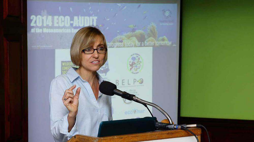 During the launch of the 2014 Eco-Audit in Belize City, Melanie indicates the small amount of progress measured in that evaluation. Credit: Alexander Ellis / Oceana.