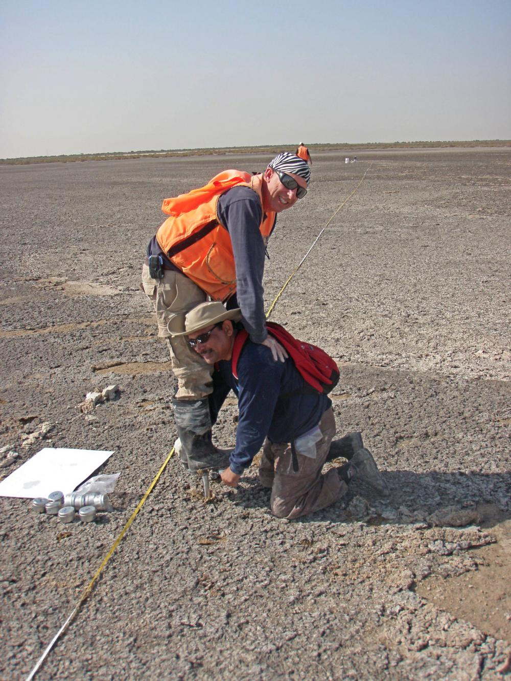 Dr. Das and Pat Megonigal work hard to collect a core from the coastal sabkha of Abu Dhabi. Photo credit Lisa Schile.