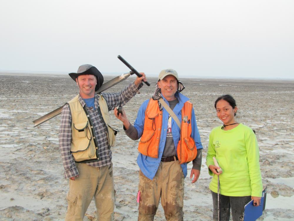 Pat Megonigal (center) with members of his team in Abu Dhabi. Photo credit Boone Kauffman.