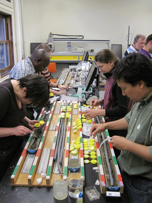 Twenty-two researchers from around the world participated in the Olorgesailie core workshop. The team collected samples every 48 centimeters in order to carry out many different kinds of environmental analysis. Photo credit: Smithsonian Institution.